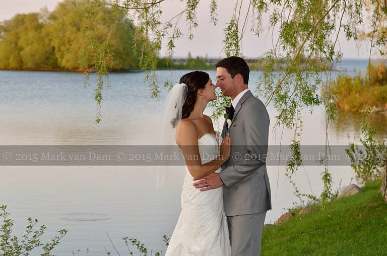 Collingwood photographer, wedding couple by the water at sunset at Cranberry Resort Bear Estate Living Waters wedding
