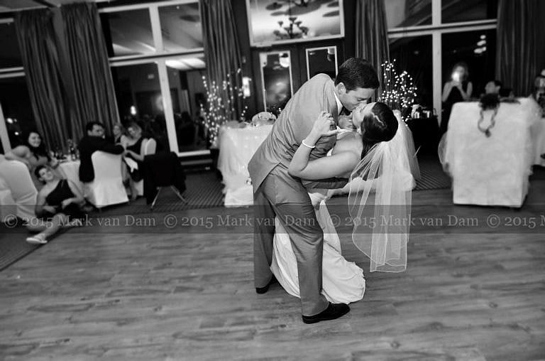 Collingwood photographer, groom dips bride during first dance at Cranberry Resort Bear Estate Living Waters wedding
