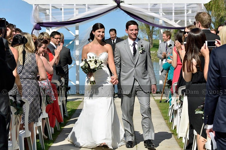 collingwood photographer, wedding couple walks hand in hand up aisle after wedding ceremony at Cranberry Resort Bear Estate Living Waters wedding