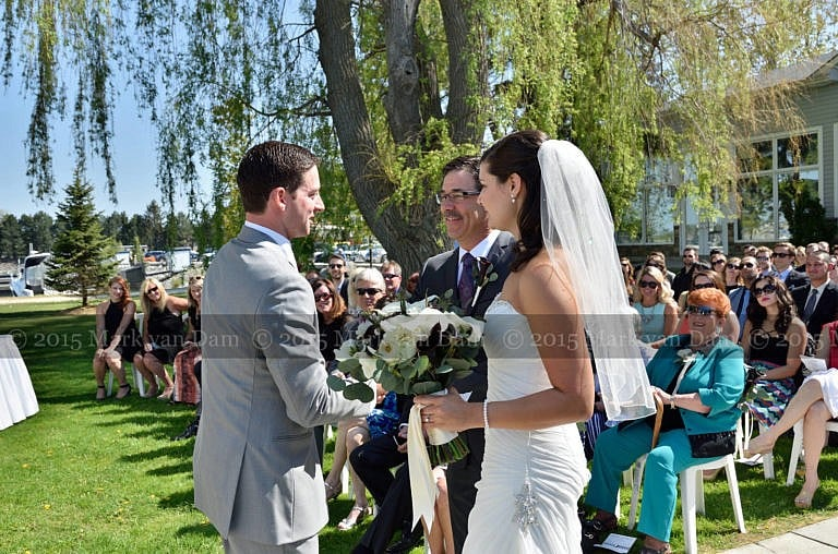 Collingwood photographer, groom shakes bride's father's hand at beginning of Cranberry Resort wedding