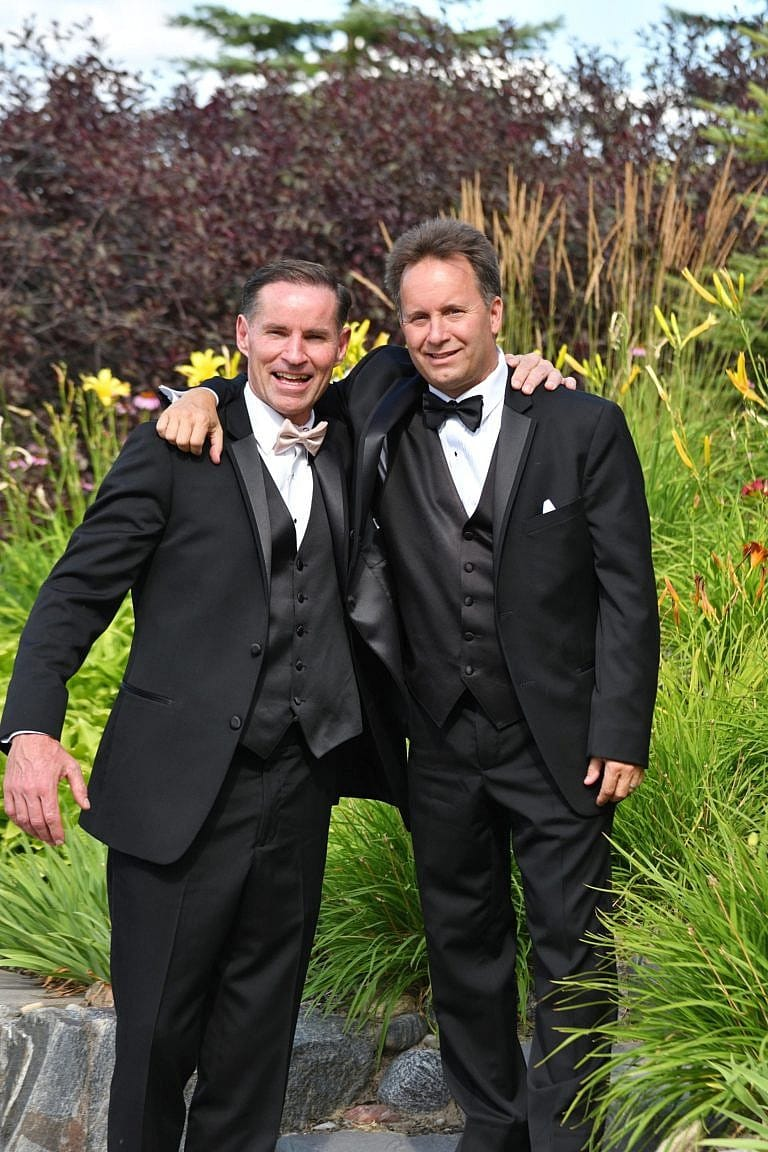 Groom with groomsman on golf course at Bond Head