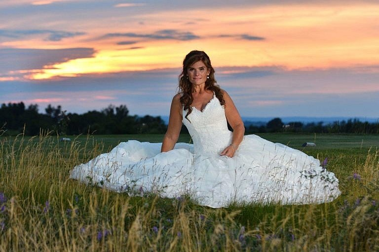 Bride at sunset on golf course at Bond Head wedding photography session