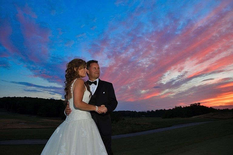 Stylish wedding couple on golf course at the Club at Bond Head wedding at night