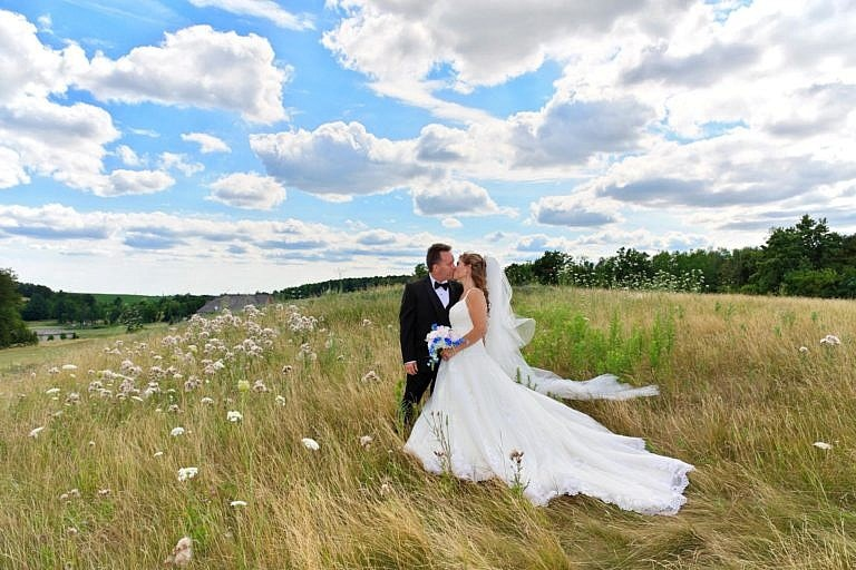 Bride and Groom in meadow at The Club at Bond Head wedding