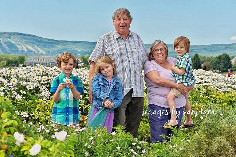 Proud Grandparents pose with their Grandchildren in lush flower garden collingwood family portraits shipyards portraits collingwood photographer