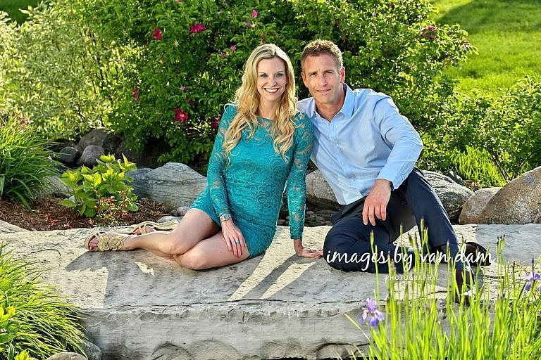 Stylish couple sits on flat rock in rose garden collingwood photographer collingwood portraits