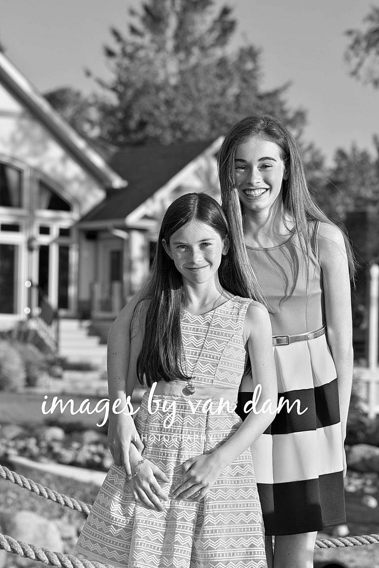 Sisters Smile in front of their home in Collingwood collingwood photographer collingwood portraits