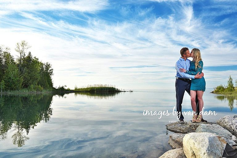 Couple Kisses on Point on Georgian Bay near the Blue Mountains collingwood photographer collingwood portraits